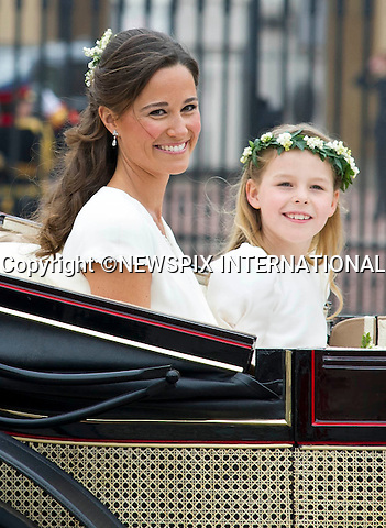 "PIPPA MIDDLETON.THE ROYAL WEDDING.The Newly married couple The Duke and Duchess of Cambridge take in the splendor of the crowds on thier way from Westminster Abbey to Buckingham Palace in the wedding Carriages..Prince William and Catherine Middleton marry at Westminster Abbey..The Duke and Duchess of Cambridge London_29/04/2011.Mandatory Photo Credit: ©Dias/Newspix International..**ALL FEES PAYABLE TO: ""NEWSPIX INTERNATIONAL""**..PHOTO CREDIT MANDATORY!!: NEWSPIX INTERNATIONAL(Failure to credit will incur a surcharge of 100% of reproduction fees)..IMMEDIATE CONFIRMATION OF USAGE REQUIRED:.Newspix International, 31 Chinnery Hill, Bishop's Stortford, ENGLAND CM23 3PS.Tel:+441279 324672  ; Fax: +441279656877.Mobile:  0777568 1153.e-mail: info@newspixinternational.co.uk"