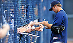 5 March 2011: Yankee fans seek out autographs through an opening in the practice field fences prior to a Spring Training game between the Washington Nationals and the New York Yankees at George M. Steinbrenner Field in Tampa, Florida. The Nationals defeated the Yankees 10-8 in Grapefruit League action. Mandatory Credit: Ed Wolfstein Photo