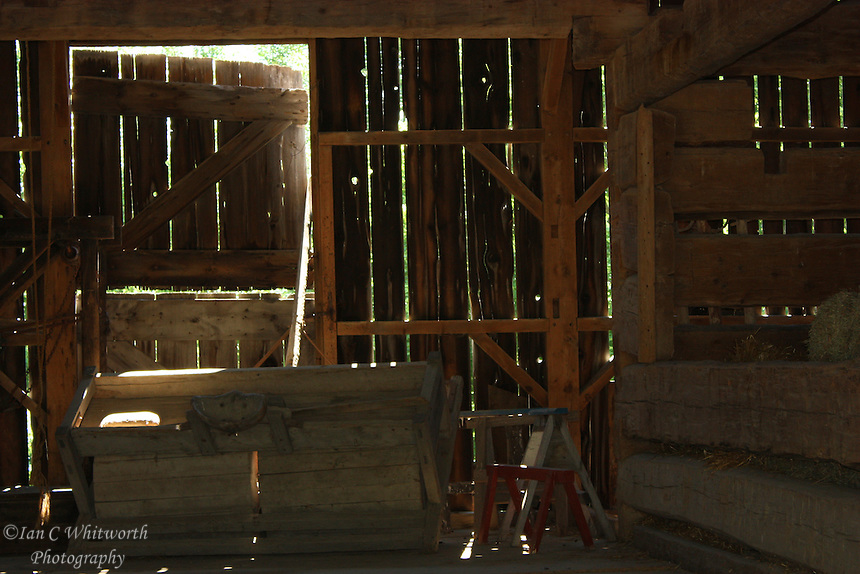 Sunlight enters the barn through the gaps in the boards at Black Creek Pioneer Village in Toronto Canada