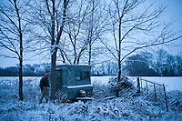 Donovan Nokes closes up his hunting blind after an unsuccessful afternoon waiting for deer on Monday, December 5, 2011 in Webster City, IA.