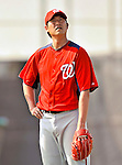 20 February 2011: Washington Nationals' pitcher Chien-Ming Wang looks up at some passing birds during Spring Training at the Carl Barger Baseball Complex in Viera, Florida. Mandatory Credit: Ed Wolfstein Photo