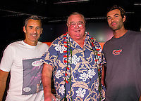 """HONOLULU, Turtle Bay Resort, North Shore, Oahu. - (Thursday, January 3, 2013) Garrett MacNamara (HAW) and Kohl Christensen (HAW) with Chris Greg Noll (USA)  who was the guest  speaker of Talk Story at Surfer The Bar tonight. Noll, nicknamed """"Da Bull"""" by Phil Edwards in reference to his physique and way of """"charging"""" down the face of a wave is an American pioneer of big wave surfing and is also acknowledged as a prominent longboard shaper. Noll was a member of a US lifeguard team that introduced Malibu boards to Australia around the time of the Melbourne Olympic Games. Noll became known for his exploits in large Hawaiian surf on the North Shore of Oahu. He first gained a reputation in November 1957 after surfing Waimea Bay in 25-30 ft surf when it had previously been thought impossible even to the local Hawaiians. He is perhaps best known for being the first surfer to ride a wave breaking on the outside reef at the so-called Banzai Pipeline in November 1964...It was later at Makaha, in December 1969, that he rode what many at the time believed to be the largest wave ever surfed. After that wave and the ensuing wipeout during the course of that spectacular ride down the face of a massive dark wall of water, his surfing tapered off and he closed his Hermosa Beach shop in the early 1970s. He and other surfers such as Pat Curren, Mike Stang, Buzzy Trent, George Downing, Mickey Munoz, Wally Froyseth, Fred Van Dyke and Peter Cole are viewed as the most daring surfers of their generation...Noll is readily identified in film footage while surfing by his now iconic black and white horizontally striped """"jailhouse"""" boardshorts and was interviewed by host Jodi Wilmott (AUS). . Photo: joliphotos.com"""