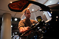 New york, United States. 18th January 2013 -- A man tests a BMW motorcycle during The International Motorcycle Show in New York. -- BMW, Ducati, Harley-Davidson, Honda, Kawasaki, Suzuki, Star, Triumph, Victory, Yamaha and more have all utilized the International Motorcycle Shows to unveil new motorcycles and concept vehicles to the world. Photo by Eduardo Munoz Alvarez / VIEWpress.