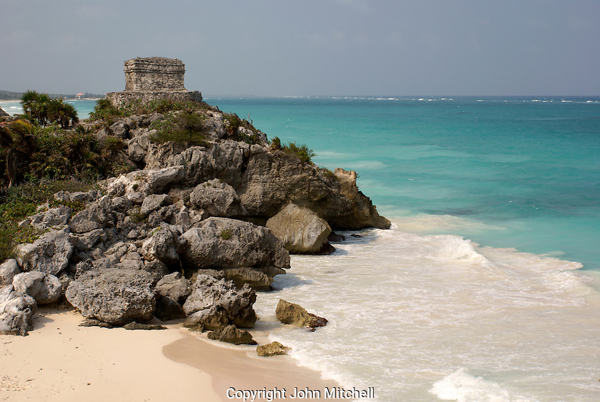 Temple of the Wind God and beach at the Mayan ruins of Tulum on the Riviera Maya, Quintana Roo, Mexico.