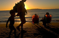Beachgoers enjoy the last rays of sun and sand on the Playa Mansa beach in Punta del Este, Uruguay. The venerable South American beach resort is having a rennaisance. (Kevin Moloney for the New York Times)