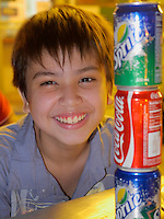 Boy with Coca Cola and Sprite Cans