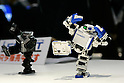 i-Sobot Micro Humanoid Robot during a demonstration at the International Robot Exhibition in Tokyo on November 27, 2009. 200 robot companies and institutes exhibit their latest robot technologies during a four-day exhibition (photo Laurent Benchana/Nippon News).