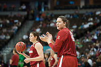 DENVER, CO--Sarah Boothe shows support for her teammates during a team open practice session at the Pepsi Center for the 2012 NCAA Women's Final Four festivities in Denver, CO.