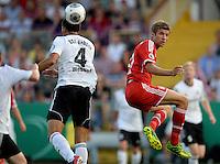 FUSSBALL       DFB POKAL 1. RUNDE        SAISON 2013/2014 BSV Schwarz-Weiss Rehden  - FC Bayern Muenchen  05.08.2013 Michael Wessel (li, Rehden) gegen Thomas Mueller (re, FC Bayern Muenchen)