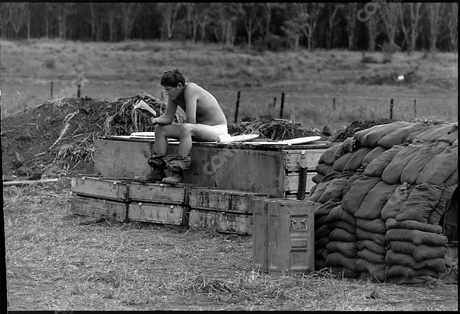 US soldier using an outdoor latrine like most firebases were equiped with. Near Quang Ngai, South Vietnam, November 1970
