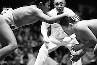 A Young Rikishi Sumo wrestler attempts to push his opponent to the floor..450 children, aged between 11-14, qualified for  the All Japan Wanpaku Sumo Tournament. The  Ryogoku Kokugikan Stadium, Tokyo, Japan.