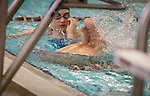 Lehi High School swimmer Amy Chapman's amputated legs can be seen coming out of the water as she performs a flip turn during practice at the Lehi Legacy Center, Tuesday, Dec. 18, 2012.