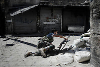 SYRIA, ALEPPO. A Syrian rebel take position to fire toward regime forces, in the Old City of Aleppo on September 24, 2012 ALESSIO ROMENZI
