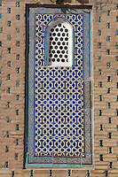 Detail of wall decoration in the courtyard of the Harem,  Tash Khauli Palace, 1830-38, Khiva, Uzbekistan, Khiva, Uzbekistan, pictured on July 7, 2010, in the afternoon. Commissioned by Allah Kuli Khan the Tash Kauli palace is a huge complex containing 163 rooms which took its architects, Tajiddin and Kalandar, 10 years to build. The harem, occupying about half of the palace has 5 aiwan terraces, with delicately carved wooden pillars,  behind which were the quarters for the khan and his wives. Across the courtyard were the  concubines' apartments.  The facades and walls around the courtyards were decorated with traditional blue, ultramarine and white colours majolica made by Abdullah. Khiva, ancient and remote, is the most intact Silk Road city. Ichan Kala, its old town, was the first site in Uzbekistan to become a World Heritage Site(1991). Picture by Manuel Cohen.