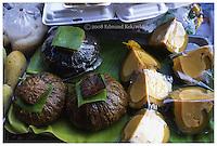 A sophisticated street food option.  Baked custard in a squash.  Pentax Spotmatic film camera. 2008
