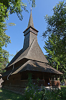 Wooden church from Dragomiresti village.  35m high spire. Built: 1722. Dimitrie Gusti National Village Museum (Muzeul Satului) in Bucharest, Romania