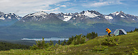 Panorma of photographer taking pictures of the Kenai mountains, southcentral, Alaska.