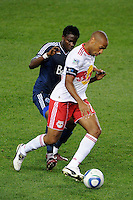 Thierry Henry (14) of the New York Red Bulls is marked by Gershon Koffie (28) of the Vancouver Whitecaps. The New York Red Bulls and the Vancouver Whitecaps played to a 1-1 tie during a Major League Soccer (MLS) match at Red Bull Arena in Harrison, NJ, on September 10, 2011.