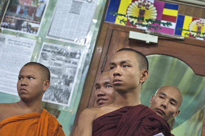 Monks listen to Buddhist monk Ashin Wirathu at Mae Soe Yein monastery in Mandalay. Behind them, on the left, is the 969 symbol. Wirathu is the most vocal advocator of  the 969 movement that encourages Buddhists to only shop at Buddhist owned shops with stickers to identify them.