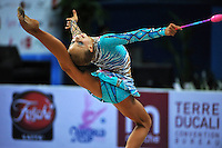 Diana Borisova (junior) of Russia performs with clubs at 2010 Pesaro World Cup on August 27, 2010 at Pesaro, Italy.  Photo by Tom Theobald.
