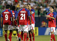 Costa Rica's captain Freddy Fernandez (3) consoles Froylan Ledezma (21) after Ledezma failed to convert his penalty kick.  Mexico defeated Costa Rica 2-1 on penalty kicks in the semifinals of the Gold Cup at Soldier Field in Chicago, IL on July 23, 2009.