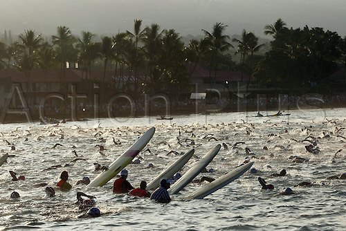 Some 1800 triathletes start in the Ironman Triathlon World Championships in Kailua-Kona, Hawaii, USA. 10th October 2009. They have to swim 3.8 kilometres in the surf of the Pacific Ocean, cycle 180 kilometres and complete a marathon. Photo by Thomas Frey/ActionPlus. UK Licenses Only.