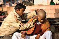 Shaving the head on visiting the Ganges is thought to bring spiritual purification.<br /> (Photo by Matt Considine - Images of Asia Collection)