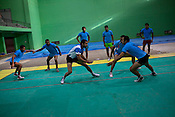 A raider is seen at the defendant court during the kabbadi training sessions as part of the training at a month long camp for the Indian national Kabbadi team in Sport Authority of India Sports Complex in Bisankhedi, outskirts of Bhopal, Madhya Pradesh, India.
