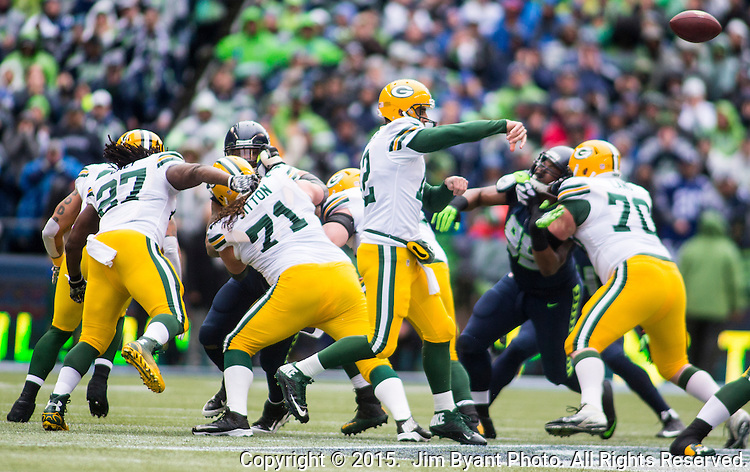 Green Bay Packers quarterback Aaron Rodgers passes against the Seattle Seahawks during the NFC Championship game at CenturyLink Field in Seattle, Washington on January 18, 2015.  The Seattle Seahawks beat the Green Bay Packers in overtime 28-22 for the NFC Championship Seattle.  ©2015. Photo by Jim Bryant.  All Rights Reserved.