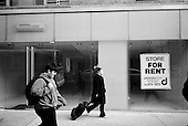 February 12, 2009.New York, New York.USA..The economic crisis hits the golden mile of Madison Avenue as many businesses can not afford the high rental rates. Madison Avenue from the 50's to the 90's is pock-marked with dozens of empty shops looking for renters.