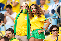 Brazil fans in yellow and green