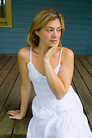 Blonde woman sitting on porch