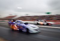 May 1, 2016; Baytown, TX, USA; NHRA funny car driver Jack Beckman (near) races alongside Tim Wilkerson during the Spring Nationals at Royal Purple Raceway. Mandatory Credit: Mark J. Rebilas-USA TODAY Sports