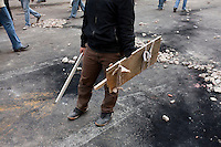 A man with improvised shield and weapon on Tahrir Square. Throughout Friday, 4 February, anti government protesters protected their positions from pro Mubarak supporters around Tahrir square, the scene of heavy clashes between pro and anti government protesters. Continued anti-government protests take place in Cairo calling for President Mubarak to stand down. After dissolving the government and allowing for talks with opposition parties Mubarak still refuses to step down from power...