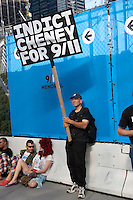 """A protester holds a sign proposing to """"Indict Cheney for 9/11""""."""
