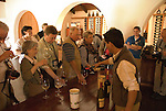 Chile Wine Country: Tasting room at Undurraga Winery, Vina Undurraga, near Santiago.  Tourists in tasting room, sampling wine..Photo #: ch444-32847.Photo copyright Lee Foster, 510-549-2202, www.fostertravel.com, lee@fostertravel.com.
