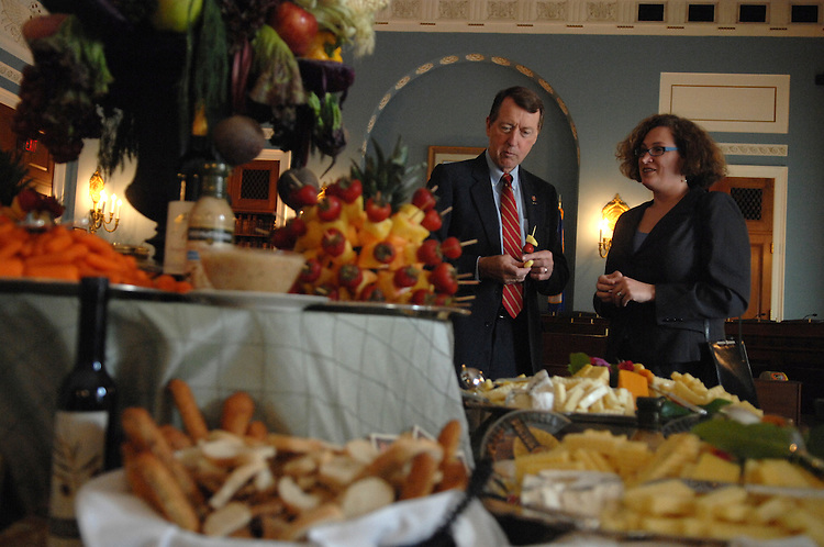 Rep. Bob Etheridge, D-N.C., samples cheese with Laura Trivers, at a wine and cheese reception hosted by the Congressional Wine Caucus and Congressional Organic Caucus held to sample wines and products farmed by organic and sustainable methods. .