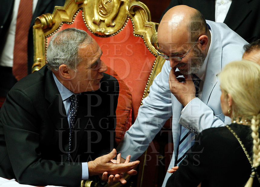 Il Presidente del Senato Pietro Grasso parla al senatore del MoVimento 5 Stelle Vito Crimi, a destra, durante la discussione sulla mozione di sfiducia nei confronti del Ministro dell'Interno e Vicepresidente del Consiglio, al Senato, Roma, 19 luglio 2013.<br /> Italian Senate President Pietro Grasso talks to Five Stars Movement's Senator Vito Crimi, right, during a plenary session for the discussion of a no confidence motion against Interior Minister and Deputy Premier, at the Senate in Rome, 19 July 2013.<br /> UPDATE IMAGES PRESS/Riccardo De Luca