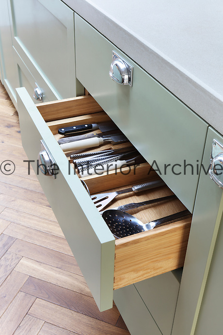 Detail of a bespoke kitchen drawer, with sturdy dovetail joints and inserts especially designed for housing kitchen utensils