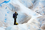 A photographer photographing Glacier Perito Moreno in the Parque Nacional los Glaciares, Argentina.