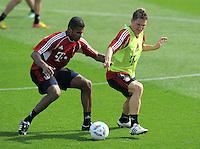 Fussball 1. Bundesliga:  Saison   2011/2012    Winter Trainingslager des FC Bayern Muenchen  03.01.2012 Breno (li) gegen Bastian Schweinsteiger