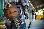 A musician waits in the wings before taking the stage at the Kingman Bluegrass Festival in Washington, DC.