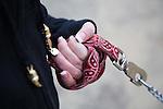 Margaret B. Jones holding the leash of her pit bull, Flue.