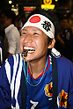 June 19, 2010 - Tokyo, Japan - A Japanese supporter cheers during the 2010 World Cup football match Netherlands vs Japan on June 19, 2010 at Shibuya district, Tokyo, Japan. The Netherlands defeated Japan 1-0.
