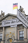 Unter den Linden sign with Zeughaus (German History Museum) on background