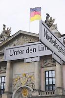 Unter den Linden sign with Zeughaus (German History Museum) on background