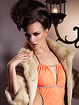 Fashion photo of a beautiful woman wearing a swimsuit and a fur jacket
