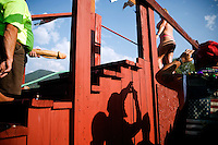 A man uses a wooden penis attached to a hose to spray a contestant in the wet t-shirt contest at the Testicle Festival at the Rock Creek Lodge in Clinton, MT.  The Rock Creek Lodge in Clinton, MT, has hosted the annual Testicle Festival since the early 1980s.  The four day festival and party revolves around the consumption of so-called Rocky Mountain Oysters, which are deep-fried bull testicles.