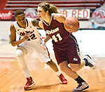 "Mississippi's Tia Faleru (32) defends UMass' Kiara Bomben (41) at the C.M. ""Tad"" Smith Coliseum in Oxford, Miss. on Saturday, December 8, 2012. (AP Photo/Oxford Eagle, Bruce Newman)"