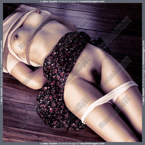 Undressed nude young asian woman Lying on the floor naked tied with rope bondage Shibari